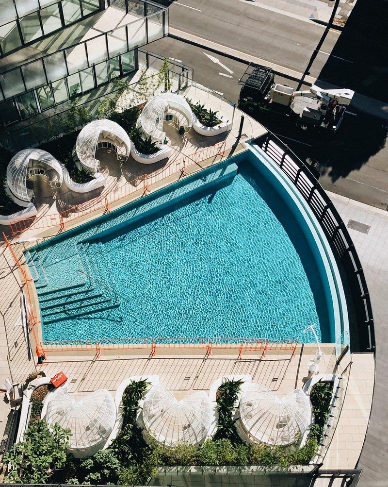 Infinity by Crown Group - aerial view - pool